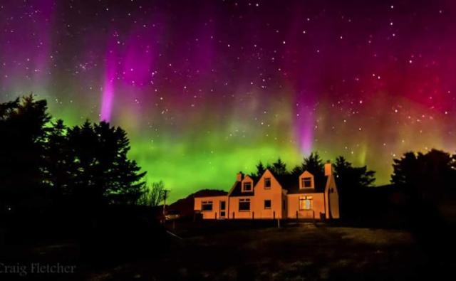 478664-northern-lights-on-the-outskirts-of-portree-by-craig-fletcher